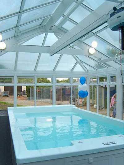 Interior view of portal structure created by Cheadle Glass, featuring Ultraframe roof